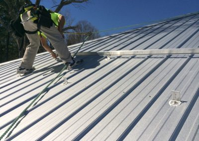 Crew Working on a Metal Roof