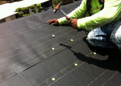 Crew Repairing Roof Shingles